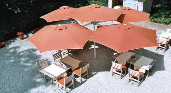 multi terracotta colour umbrella installation for restaurant