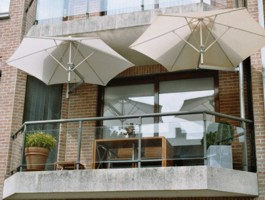 Two wall mounted Paraflex Umbrellas on a balcony