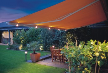 retractable awning with lights over restaurant dining area