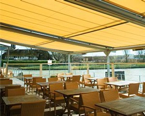 Markilux RS-8000 supporting a Markilux 8000 awning in a commercial dining area.