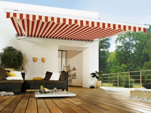 Red and Cream Striped narrow Markilux 1600 stretch over a decking