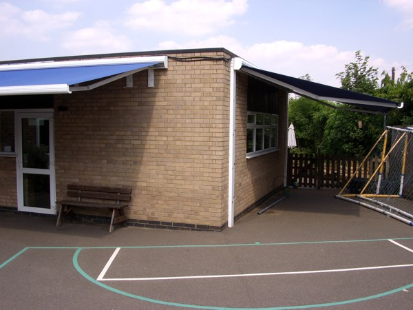 Awning with supporting legs offering sun protection in school