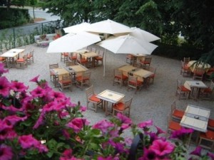 Bunch of paraflex umbrellas in a restaurant viewed from above