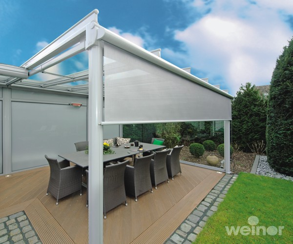 Weinor VertiTex vertical awning by garden dining area