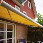 Yellow buttermere awning over patio dining area