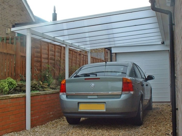 Carports polycarbonate glass canopy systems samson for Attached garage kits
