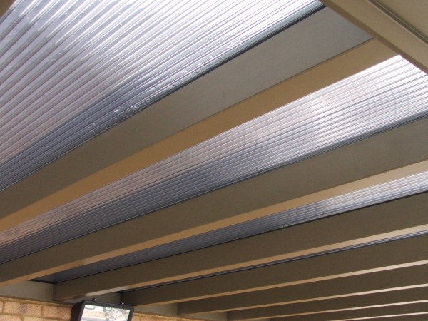 Samson Piazza carport with polycarbonate roofing - perfect for letting through any sunlight