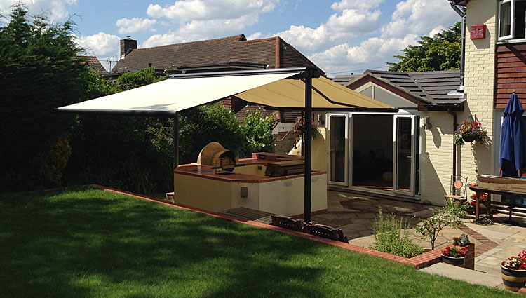butterfly syncra awning in a domestic garden