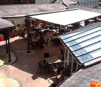 View of Markilux Syncra butterfly awning in pub garden