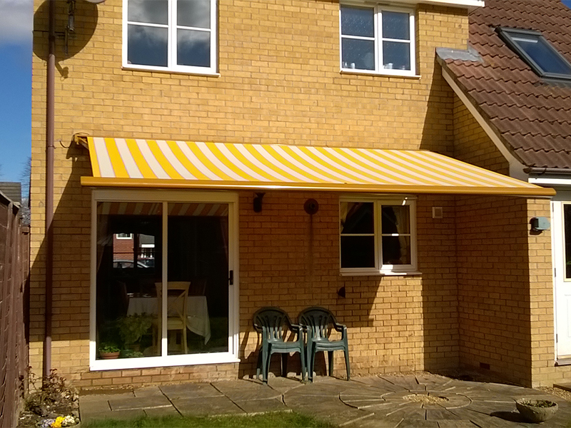 Yellow striped Markilux Awning