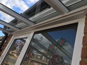 The underside of the veranda is neatly matched up with the existing window fittings.