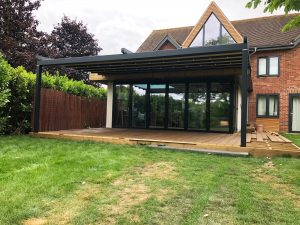 Weinor Pergotex II installed above bi-folding doors