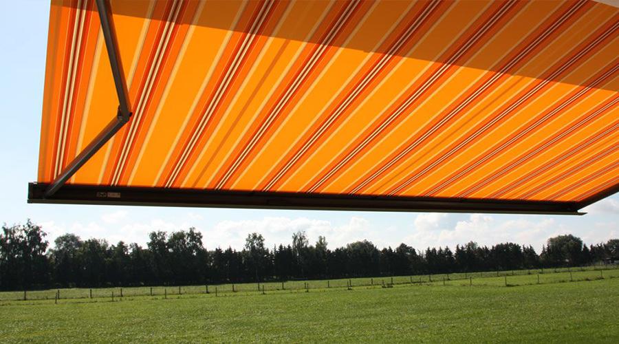 Under orange awning