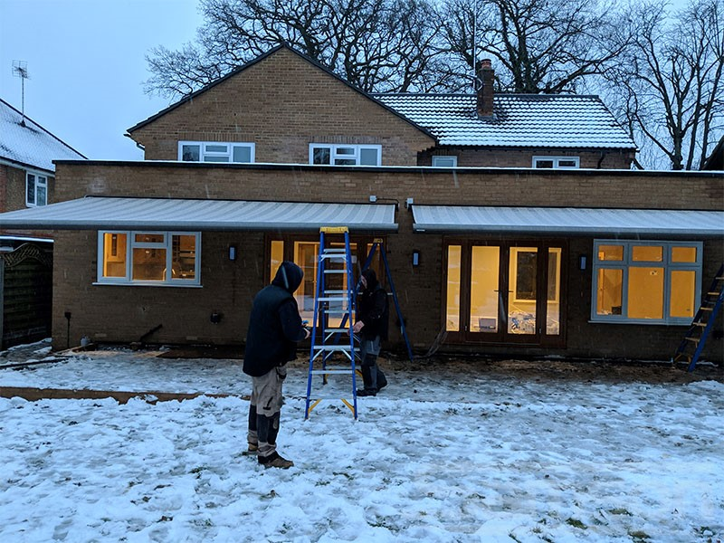 Even in the Snow our fitter are committed to getting the job done