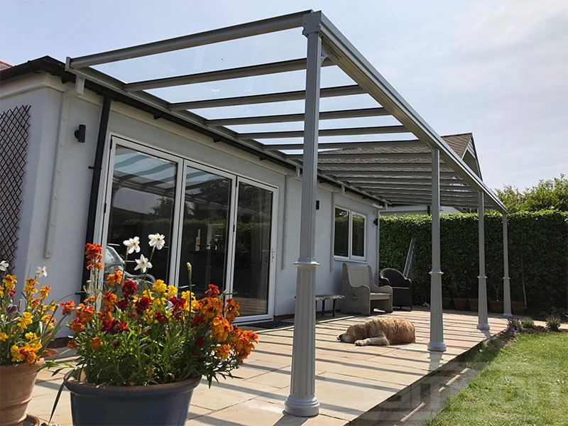 Grey Glass Terrace Cover Installation Over window and patio doors