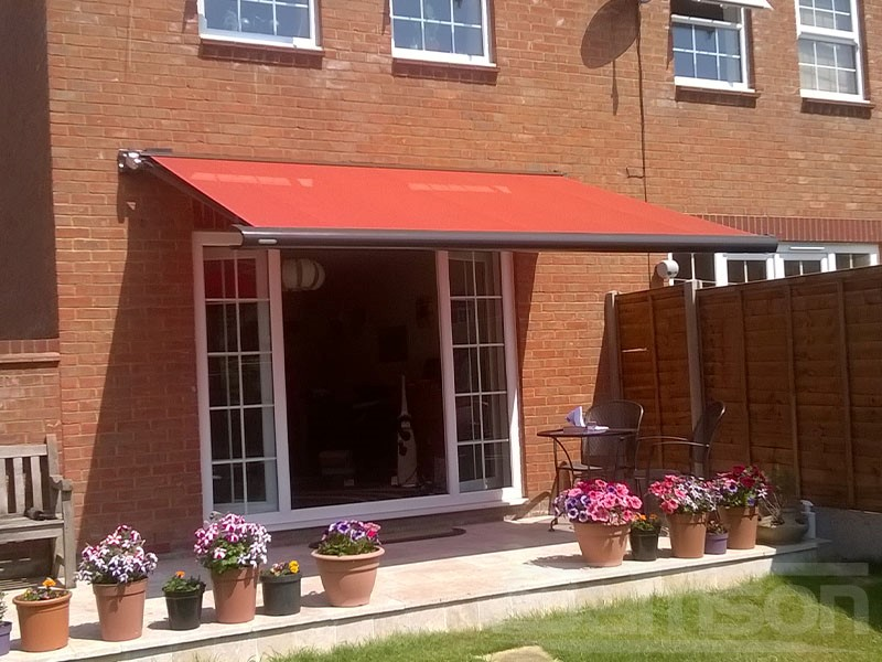 Bright Red Retractable Awning Installation