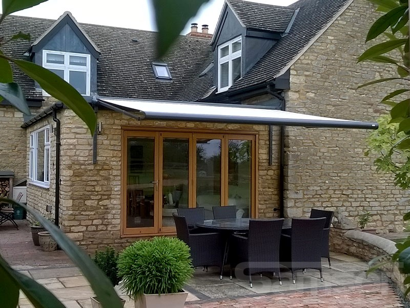 Awning Installation on Stone House