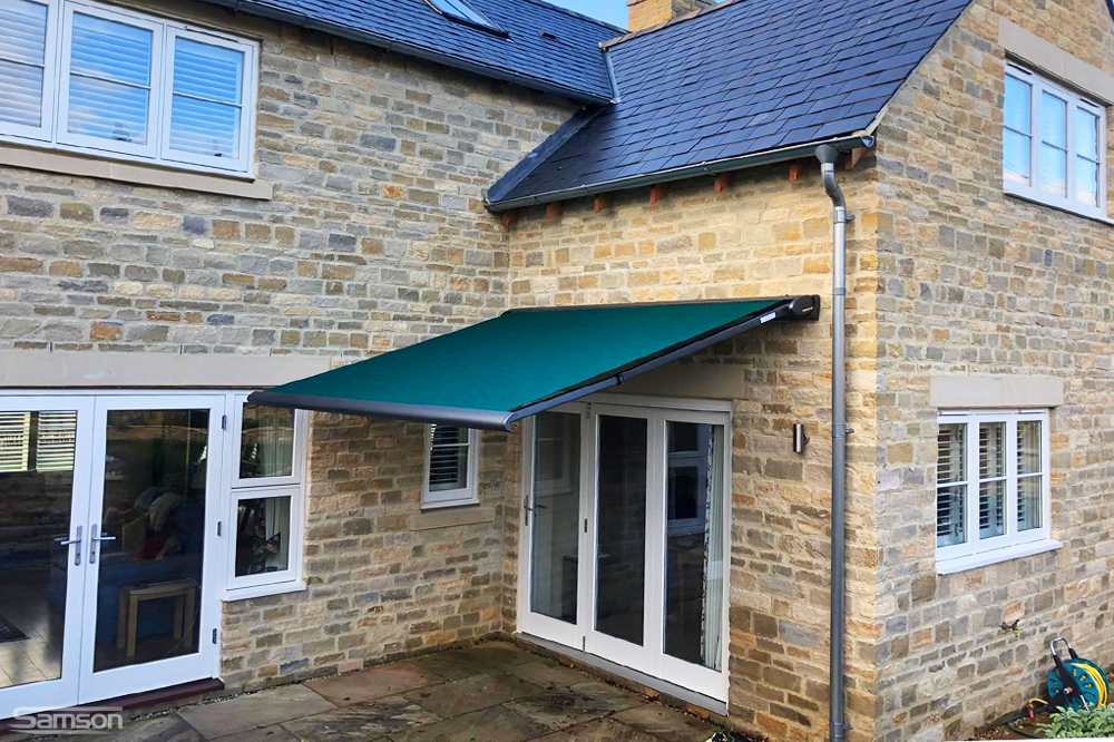 Small, Dark Green Retractable Awning