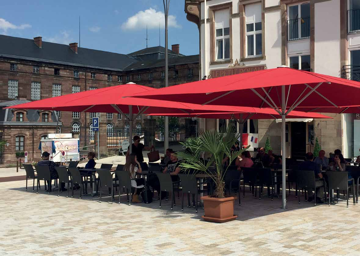 Red May Umbrellas Covering Outdoor Restaurant Seating