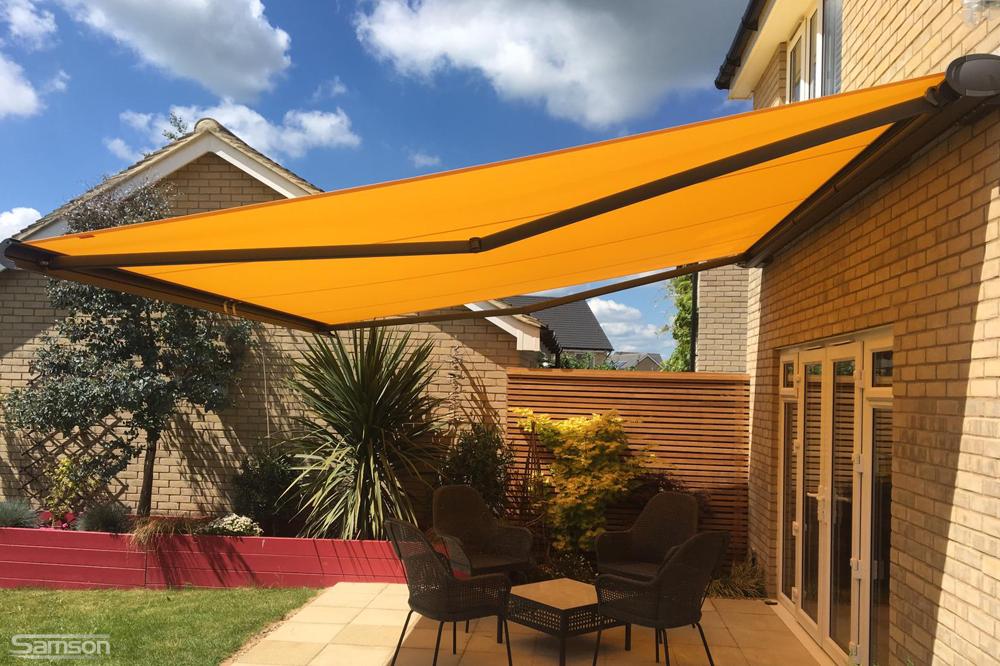 Orange Retractable Awning Shading Patio Furniture