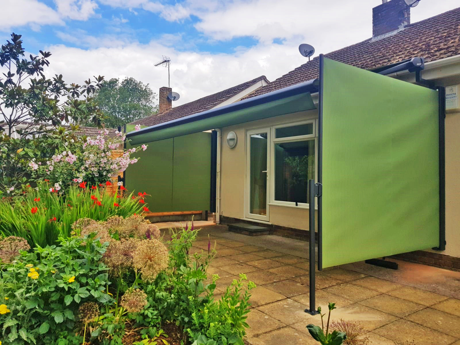 Green Markilux Pergola with Side Screens