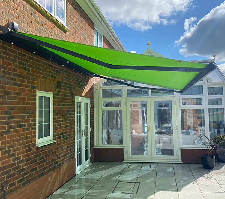 Green Retractable Awning Outside Conservatory